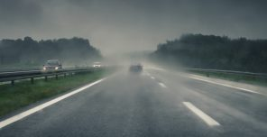 car on a road in rainy weather